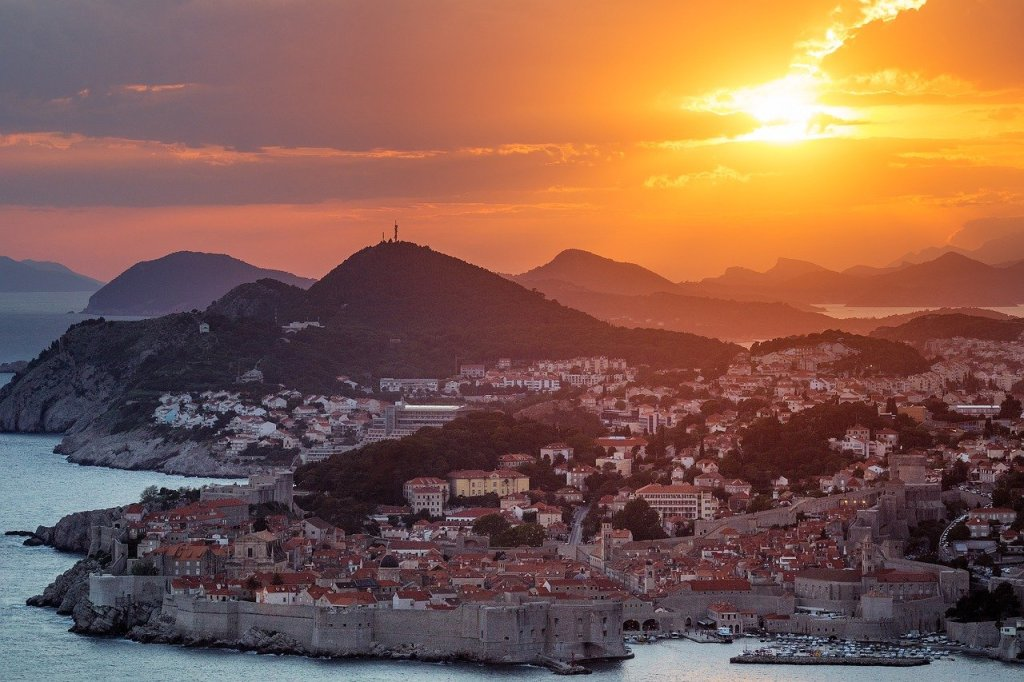 Dubrovnik cityscape at distance at sunset.